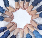 Feet of girls with jeans in a circle. Feet of young girls with jeans in a circle Stock Photo