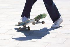 Feet girls skateboarding in the city. The feet girls skateboarding in the city royalty free stock photo