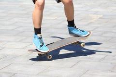 Feet girls skateboarding in the city. The feet girls skateboarding in the city stock photography