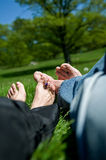 Feet on grass. Relaxed feet on the grass royalty free stock images