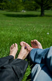 Feet on grass. Relaxed feet on the grass stock photo