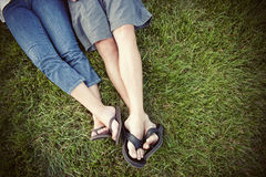 Feet in the grass. A couple's feet together in the grass Stock Photos