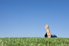 Feet grass, sky. Royalty Free Stock Images