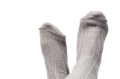 Feet with gray socks isolated on white. Background Stock Image