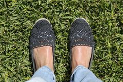 Feet on green grass. Selfie suntanned female feet on green grass Royalty Free Stock Images