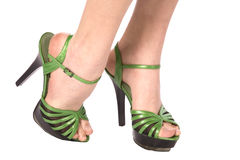 Feet green shoes Royalty Free Stock Photography