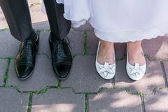 Feet of groom and bride Stock Photography
