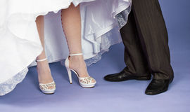 Feet of groom and bride - wedding composition Stock Photos