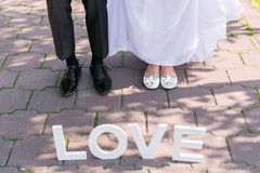 Feet of groom and bride Royalty Free Stock Photos