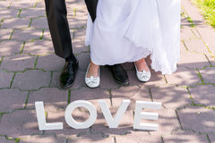 Feet of groom and bride Stock Photos