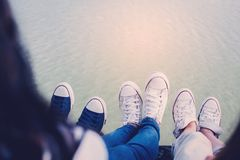 Feet of group friends enjoy in nature. Relax time on holiday concept ,selective and soft focus,tone of hipster style Royalty Free Stock Image