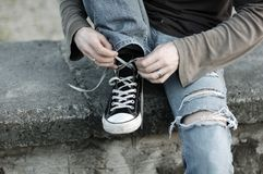 Feet guy shoes sneakers Royalty Free Stock Images