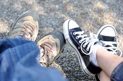 Feet and gym shoes. On the floor Royalty Free Stock Photos