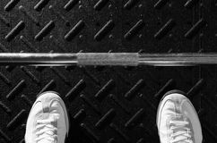 Feet in gym about to lift Stock Images