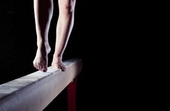 Feet of gymnast. On balance beam royalty free stock photography