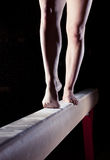 Feet of gymnast on balance beam Stock Image