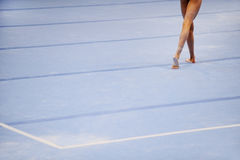 Feet on gymnastics floor royalty free stock image