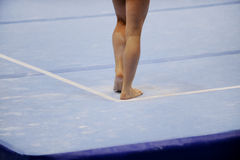 Feet on gymnastics floor stock images
