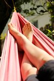 Feet in a hammock Royalty Free Stock Photography