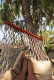 Feet in hammock. Royalty Free Stock Photo