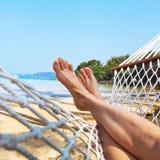 Feet in hammock Royalty Free Stock Photography
