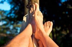 Feet in hammock  Royalty Free Stock Photos