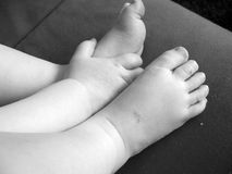 Feet & hand. Small baby hand & feet in black and white Stock Image