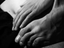 Foot and hand in black and white stock images