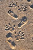 Feet and hands on the beach Stock Photography