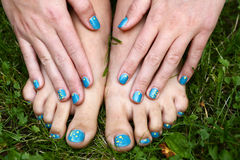 Feet and hands with creative teens manicure Royalty Free Stock Image
