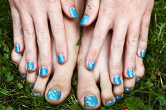 Feet and hands with creative teens manicure Royalty Free Stock Images