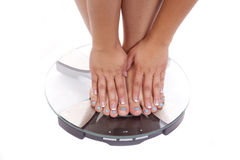 Feet and hands scales Royalty Free Stock Photography