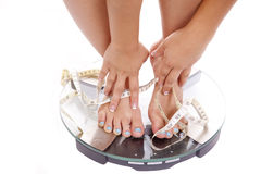 Feet and hands tape scales Royalty Free Stock Photography