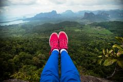 Feet hanging in the air. Tab Kak Hang Nak Hill Nature Trail. Thailand Royalty Free Stock Images
