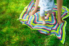 Feet happy loving mother and her child outdoors Stock Photos