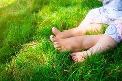 Feet happy loving mother and her child outdoors Royalty Free Stock Photography
