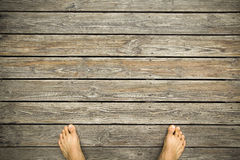feet on a hardwood floor Stock Images