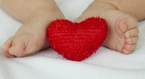 Feet and heart Royalty Free Stock Images