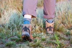 Feet of hiker walking on trail Royalty Free Stock Images