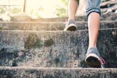 Feet of hipster girl walking in staircase forest. Background, Relax time on holiday royalty free stock images