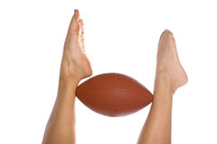 Feet holding football Stock Image