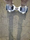 Feet on hoverboard Stock Photography