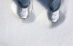 Feet In Ice And Snow Stock Photo