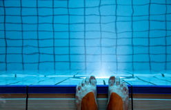 Feet in indoor swimming pool Royalty Free Stock Images
