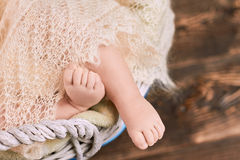 Feet of an infant. Blanket and childish legs Royalty Free Stock Image