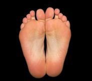 Feet Isolated On Black Stock Photography