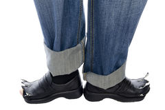 Feet in jeans and shoes on white Stock Photo