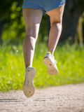Feet of a jogger Stock Images
