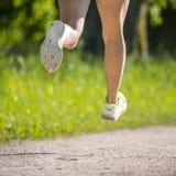 Feet of a jogger Stock Photos