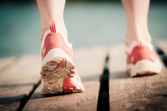 Feet of jogging woman Stock Images